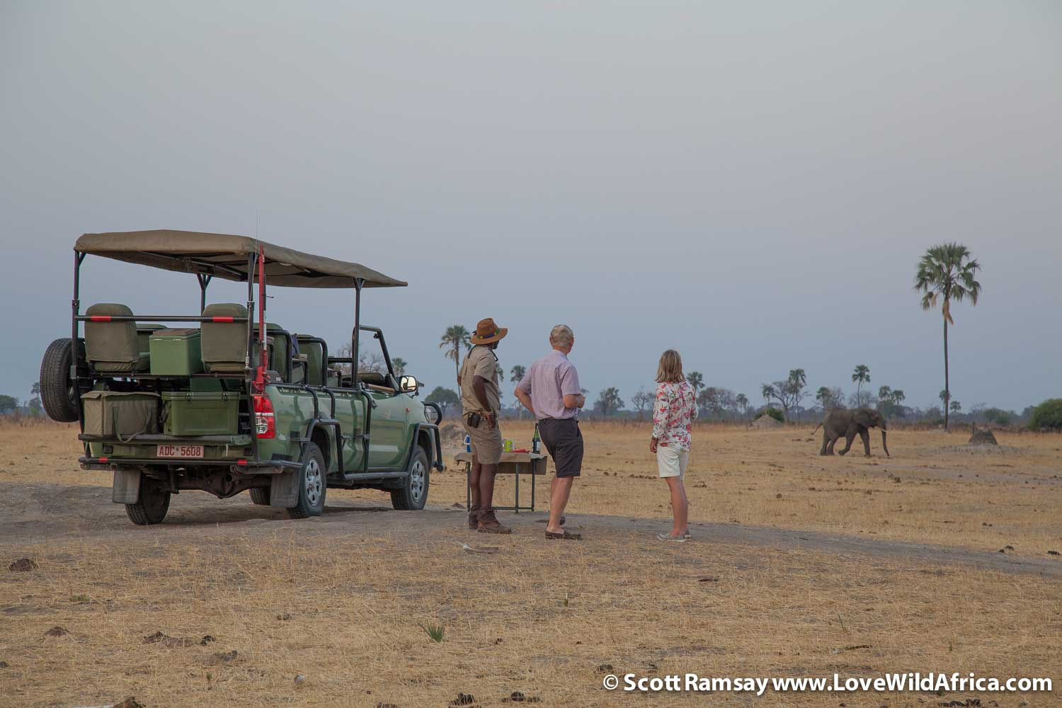 Sundowners with guests at a pan near Linkwasha...as the elephants come in to drink.